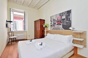 Un ou plusieurs lits dans un hébergement de l'établissement Cozy San Martino - My Extra Home