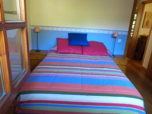 A bed or beds in a room at Francoli-Vacances Pirinenca