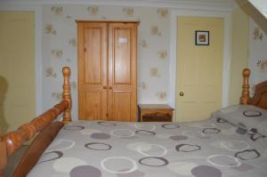 A bed or beds in a room at Apartment Dunfermline