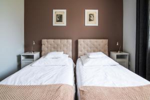 A bed or beds in a room at Apartamenty Algador