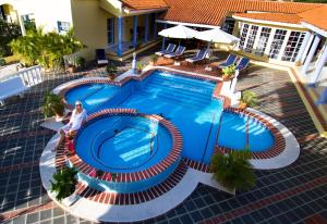 A view of the pool at La Pura Vista or nearby
