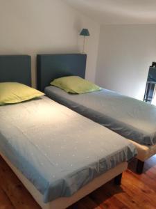 Un ou plusieurs lits dans un hébergement de l'établissement Le Servit