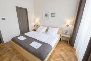 A bed or beds in a room at Bohemia Apartments Prague Centre