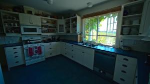 A kitchen or kitchenette at Mission Creek Farm House