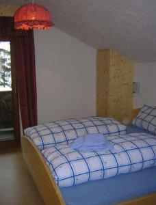 Ein Bett oder Betten in einem Zimmer der Unterkunft Gasthof Kirchbrücke