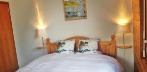 Ein Bett oder Betten in einem Zimmer der Unterkunft Les Ecureuils