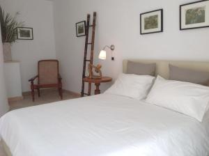 A bed or beds in a room at Villa Isabella