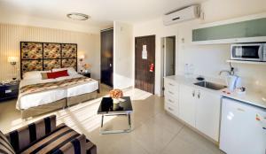 A kitchen or kitchenette at Shamai Suites Jerusalem