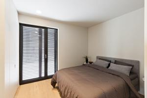 Ein Bett oder Betten in einem Zimmer der Unterkunft Villa Juliette