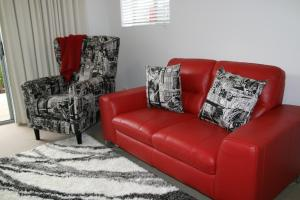 A seating area at Apartments in Canberra