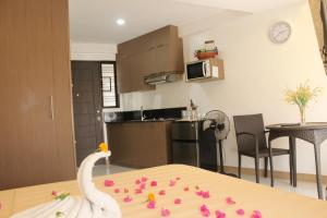 A kitchen or kitchenette at Anahaw Studio Suites