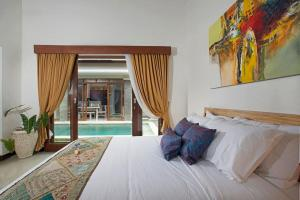 A bed or beds in a room at Villa Ashna
