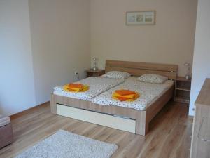 Postel nebo postele na pokoji v ubytování Ernesta Club Lipno