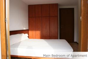 A bed or beds in a room at Eye Q Resort