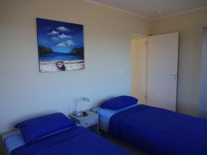 A bed or beds in a room at Haus Im Wind