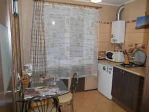 A kitchen or kitchenette at Apartments at Chernyakhovskogo 18