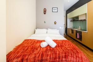 Postel nebo postele na pokoji v ubytování Tennyson - Beyond a Room Private Apartments
