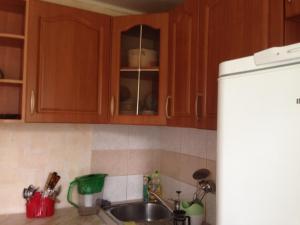 Кухня или мини-кухня в Apartment On Timme