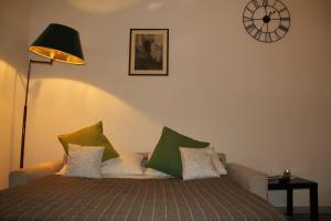 A bed or beds in a room at Vatican Gardens House