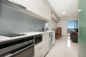 A kitchen or kitchenette at Ramada Suites by Wyndham Zen Quarter Darwin