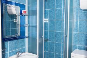 Ванная комната в Richhouse on Gogolya 33-1