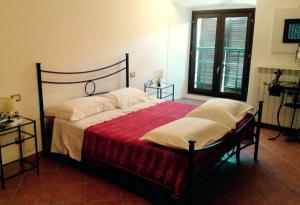 A bed or beds in a room at Residenza Le Volte Degli Angeli