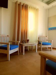 Area soggiorno di Anemos Apartments