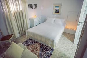 Säng eller sängar i ett rum på Villa Stella Rhodes Town