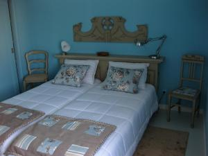 A bed or beds in a room at Villa Spozendus