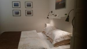 A bed or beds in a room at OESTER Bed by the Sea