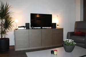 Een TV en/of entertainmentcenter bij Huisje Zeertevree