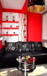 A seating area at Apartament Kielce Folk