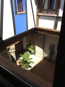 Un balcón o terraza de Apartamentos del Casco