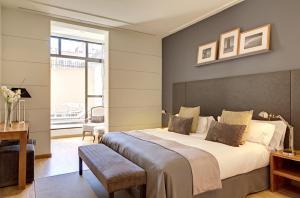 Säng eller sängar i ett rum på Apartments Sixtyfour
