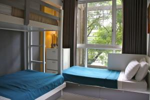 A bed or beds in a room at Condominium at Carola