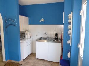 Küche/Küchenzeile in der Unterkunft Ferienhaus am Wald