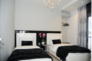 A bed or beds in a room at TiranaTOP Suites