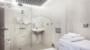 Vonios kambarys apgyvendinimo įstaigoje Konrad Old Town ApartHotel