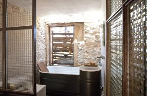 A bathroom at thesuites Ibiza Can Basso