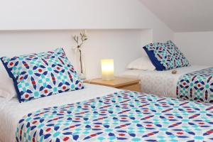 A bed or beds in a room at Born To Stay In Milfontes