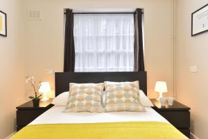 Кровать или кровати в номере City Apartments