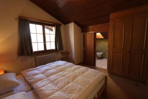 Ein Bett oder Betten in einem Zimmer der Unterkunft Les Grands Prés 31