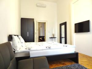 Posteľ alebo postele v izbe v ubytovaní Erzsebet Boulevard Apartment
