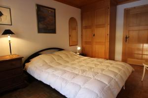 Ein Bett oder Betten in einem Zimmer der Unterkunft Forêt C13