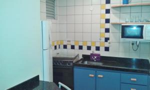 A kitchen or kitchenette at Apartamento Eldorado Thermas Park