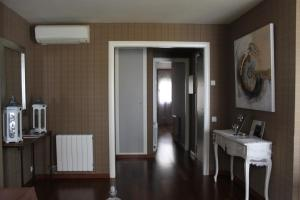 A television and/or entertainment centre at Sitges Apartment For Rent II