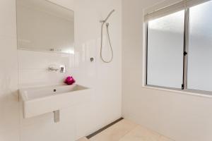 A bathroom at Cottesloe Contemporary Villa