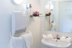 Ванная комната в Néméa Appart'hotel Toulouse Saint-Martin