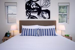 A bed or beds in a room at Domain Serviced Apartments