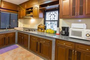 A kitchen or kitchenette at Villa Jade 4 Bedroom
